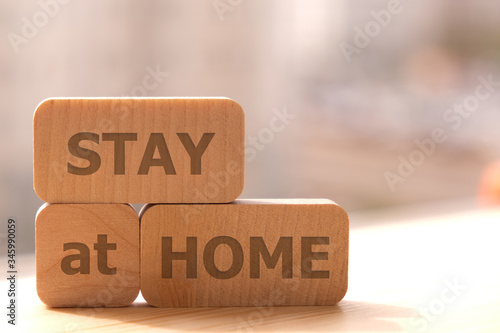 Close-up. Copy space. The concept of a coronavirus pandemic. Wooden cubes with the inscription stay at home.