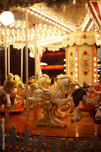 Valokuvatapetti Beautiful horse Christmas carousel. Merry-go-round with horses