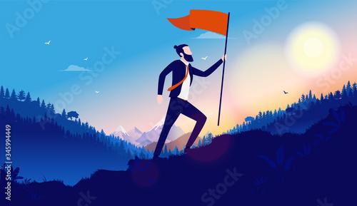Valokuva Walking up hill with flag