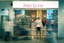 Abstract Blurred Customers Enter A First Class Lounge At Modern Asian Airport
