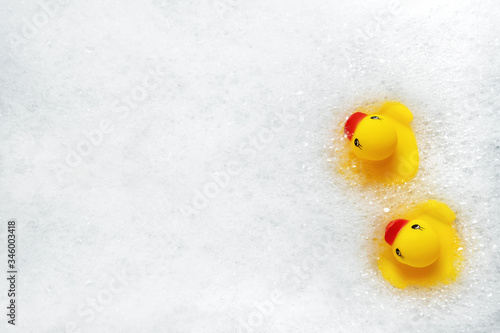 Tablou Canvas High Angle View of yellow rubber duck in bath swimming in foam water