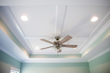 White Tray Master Bedroom Ceiling In Small New Construction House With Windows And A Ceiling Fan And Pale Blue Turquoise Walls
