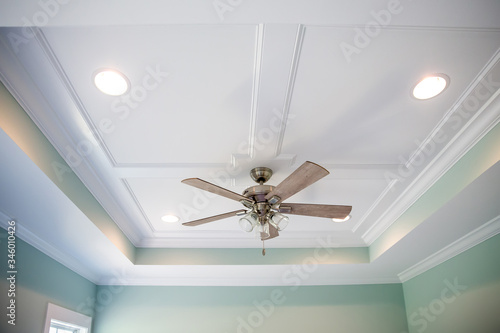 Fényképezés White tray master bedroom ceiling in small new construction house with windows a