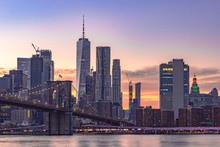 Sunset Time Cityscape Manhattan.A Lot Of Business Buildings In Line.Light Of The City It Turn On. Color Sky Very Awesome. Point View From Dumbo Brooklyn. Selective Focus.