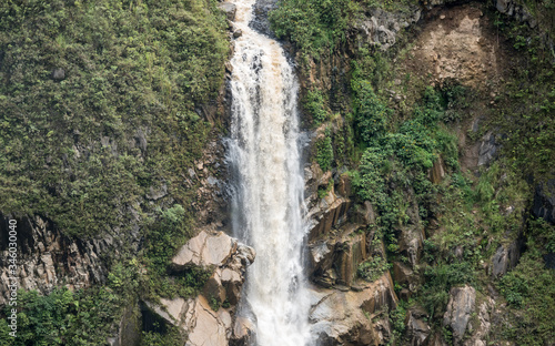 A large waterfall in Baños, Ecuador.