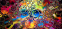 Colorful Patterns Of Oil In Water