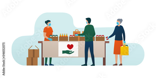 Obraz na płótnie Volunteer distributing food to people during coronavirus covid-19 epidemic