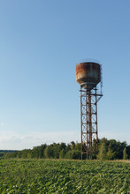 Water Tower, Sunlight And Agai...