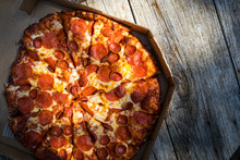 Pepperoni Pizza On A Wood Tabl...