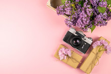 Camera, Gift And A Beautiful Purple Lilac. Month - May, June And July. Top Views With Clear Space