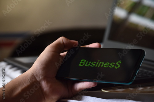 Photo cell phone showing text about business and statistics