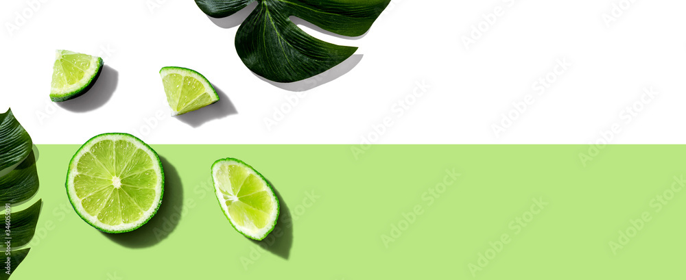 Fototapeta Fresh green limes overhead view - flat lay