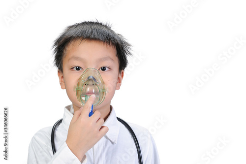 A good looking Asian boy wearing white shirt using a respirator mark to treat and alleviate the symptoms caused by the respiratory system on isolate of white backgrounds Canvas Print