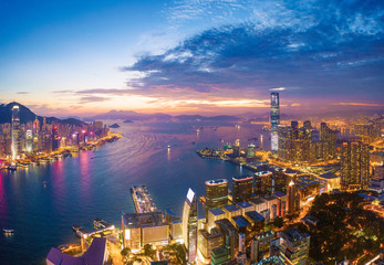 Aerial view of the Victoria Harbour, Hong Kong, at Twilight time. famous travel destination.