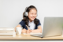 Asian Primary School Girls Taking Online Classes
