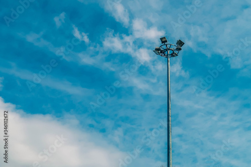 Fotografija High mast of spot light with cloud on blue sky background.