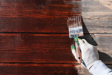 Worker In Gloves Paint A Woode...