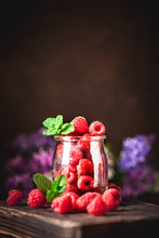 Raspberries In A Cup On A Dark...