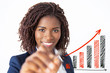 Happy friendly corporate teacher writing on growing up graphics with marker. Young African American business woman standing isolated over white background. Corporate education concept