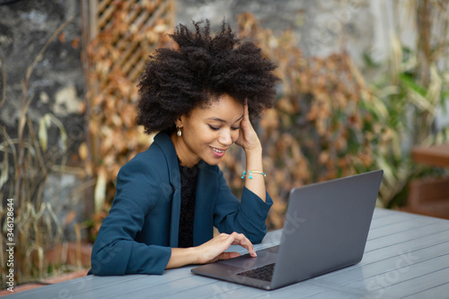 Fotografie, Tablou smiling african american businesswoman using laptop computer