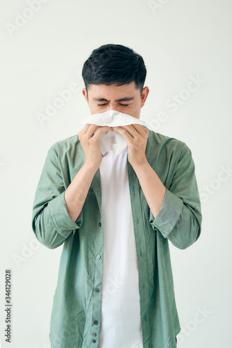 Fototapeta Sick guy isolated has runny nose.