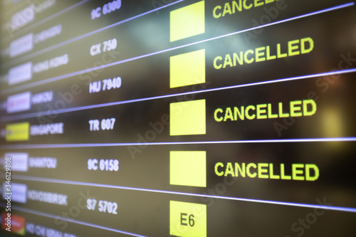 Obraz na plátně Flights cancelled and delayed on airport departure board due to covid-19 pandemic