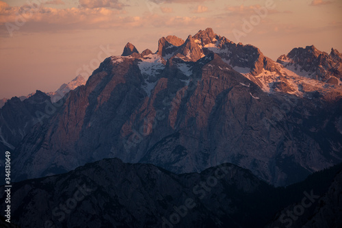 Платно Mountain landscape in the European Dolomite Alps at the Three Peaks with alpenglow during sunset, layers of mountains, South Tyrol Italy