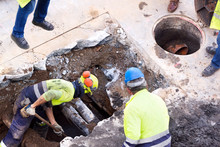Sewer  Utility Worker For Cleaning And Repairing Sewerage Pipes  In Construction Site