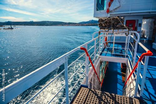 Obraz Ferry boat sailing on a sunn day in Sardinia - fototapety do salonu