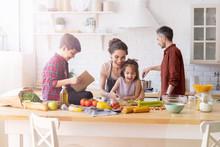 Children And Parents Cook Toge...