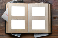 Open Old Photo Album With Place For Photos On A Wooden Table. Isolated On White.