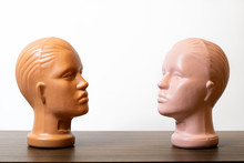 Two Mannequin Heads Face To Ea...