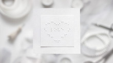 """Braille Valentine Card With The Word """"love"""" Inscribed And Used Stationary. Concept Of Accessibility, Diversity, Love, Tenderness, Valentine's Day, Blindness.  Flat Lay, Top View"""