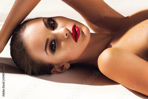 Fotografia Beautiful young model with red lips