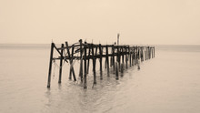 A Sepia Tone Photo Of An Old W...