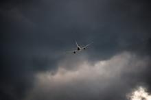 Airplane Take Off At Sunset.