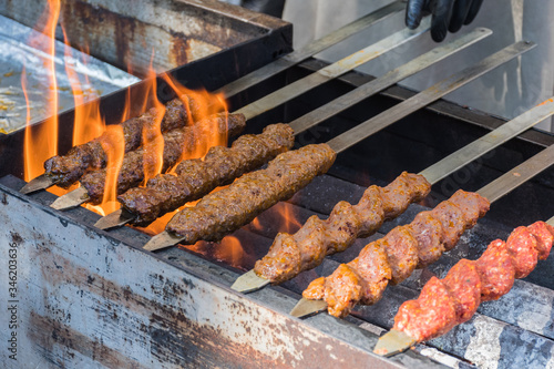 Fototapeta Adana kebab (ground lamb minced meat on skewer on grill over charcoal) obraz
