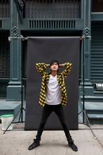 Asian Man Posing For Photo Sho...