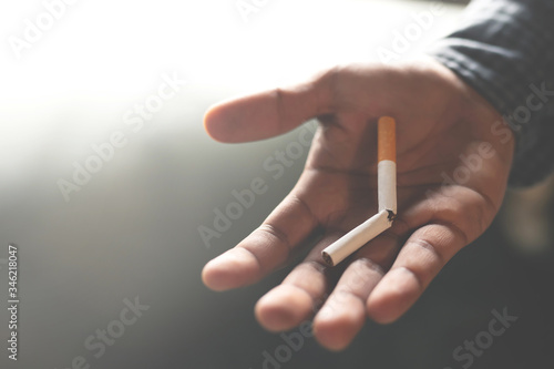 Man refusing cigarettes concept for quitting smoking and healthy lifestyle dark  background Fototapeta