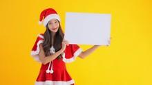 Asian Girl In Santa Costume Ho...