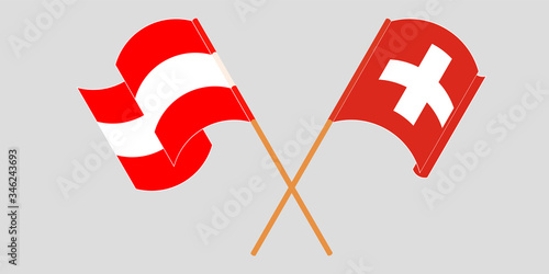 Crossed and waving flags of Switzerland and Austria Canvas Print