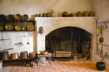 Interior Of An Old Castle With Fireplace And Kitchen.