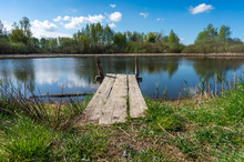 Old Rustic Wooden Jetty On A T...
