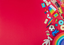 Kids Plastic And Wooden Toys On Red Background