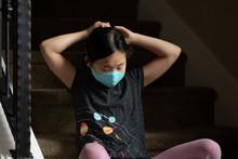 Asian Girl Adjusts Ties On Clo...