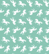Vector seamless pattern of sketch white unicorn silhouette isolated on mint background
