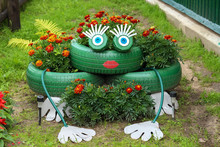 Lawn Decoration With A Green Frog Made Of Old Tires
