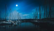 Sailboats Moored On Sea Agains...