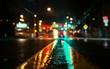 Leinwandbild Motiv Illuminated City Street During Rainy Season At Night