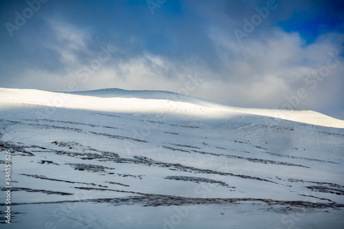 Fotografija Windswept snowcovered mountains of Iceland in winter